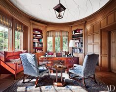 Beneath the molded-plaster ceiling of this Michael S. Smith–decorated Beverly Hills library is a George III partners' desk, a 1968 sofa by Børge Mogensen, and an antique Khotan carpet.