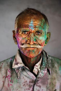 Man covered in powder at Holi Festival, India | Steve McCurry