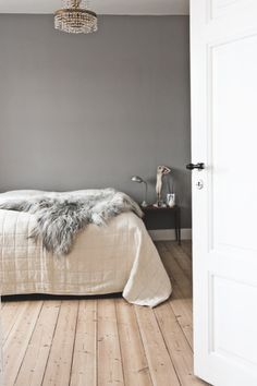 Love the grey wall, textiles and light fitting.