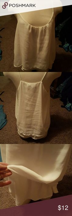 Beautiful white H&M tank Very light material can wear without a camisole underneath again you can pair up with a cardigan and blue jeans or skinny jeans and boots or a skirt beautiful must have tank great coverage H&M Tops Tank Tops
