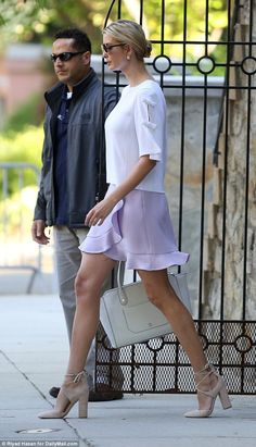 Ivanka Trumpstepped out of her Washington, D.C. home in $130 nude heels and a $275 leather handbag from her eponymous fashion line on Wednesday