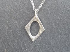 Diamond Shaped Necklace/Pendant fine silver by MeltSilver on EtsyThis fine silver pendant was handmade by me in my workshop in Cornwall, using Silver Metal Clay. It is a timeless design that will add a touch of sparkle to any outfit!