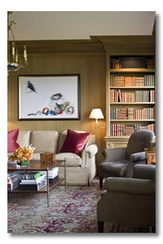 Notice the moulding going all the way up to the ceiling.  Maybe do something like this in the nook next to the fireplace (in white)?