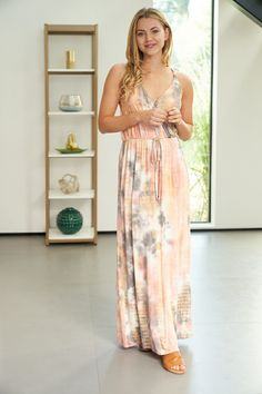 A sleeveless tie dye knit maxi dress with a V-neck featuring an elastic waistband and back criss cross detail. Fabric is soft and Rayon , SpandexModel is and is wearing a size Small. Tie Dye, V Neck, Knitting, Fabric, How To Wear, Collection, Dresses, Style, Fashion
