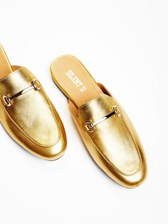 Gigi Slip-On Loafer | Sophisticated and chic leathers slip-on loafers featuring gold-toned metal hardware. Padded footbed and a small stacked heel.