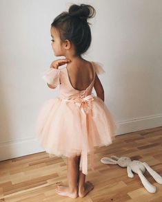 8c5d26b42a83 little girl hairstyles, child in a pale peach ballerina outfit, with a  tulle skirt