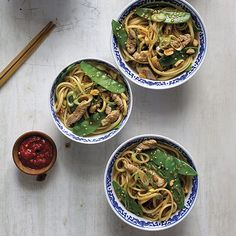 Dan Dan Noodles with Pork & Snow Peas topped with peanuts and sesame seeds