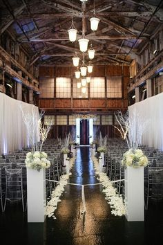 Add flowers, draping and modern chairs to change the feel from rustic to a modern feeling