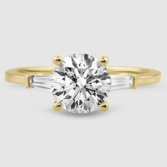 Captivating tapered baguette diamonds are bar-set in this elegant ring, brilliantly framing the center gem. Available in Yellow Gold. Gold Solitaire Ring, Baguette Diamond Rings, Rose Gold Diamond Ring, Popular Engagement Rings, Classic Engagement Rings, Baguette Engagement Ring, Engagement Ring Settings, White Gold, Wedding Shit