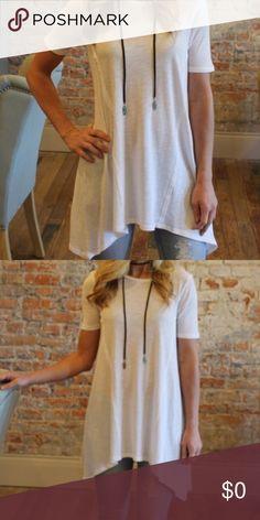 "White short sleeve longline slub tee Size medium.  60% cotton 40% modal.  Bust laying flat 17"" length 31/37"" Tops Tees - Short Sleeve"