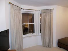 Interlined curtains with pinch pleat heading using Clarke & Clarke fabric & bay window pole from Speedy products in this lovely home
