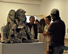 1st place winner Kelley Donahue discusses hey work at the Northeast Ceramic Sculpture Exhibition 2014