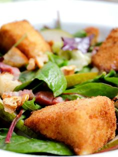 HONEY-CRUMBED CAMEMBERT SALAD WITH LARDONS AND PEAR A posh salad that will make you feel very fancy indeed! warm honey-crumbed crunchy wedges of camembert, deliciously melting on the inside.