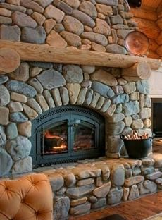 Rustic stone fireplace i wanna sit in front of this with a nice bear rug!