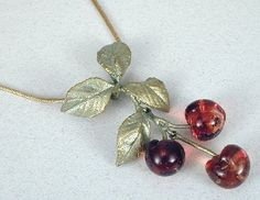 Silver Seasons - Michael Michaud - Morello Cherry Pendant Shown here is Michael Michaud's Morello Cherry Pendant rendered in Bronze and accented with hand formed glass Morello Cherries. Adjustable fro