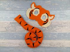 This listing is for a Tiger Mask & Matching Tail  Fun for all from 3+. - Childs Mask Measures approximately 7 x 5 inches. -Made with two layers of eco felt, machine stitched and cut by hand. TAIL: The tail is a standard size of approximately 11 inches long curled up  All of my items are