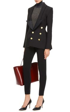 Ellery's signature fascination with silhouettes is featured in this hourglass jacket crafted in Australia. Featuring a plunging lapel, this gold detailed double-breasted jacket in black evokes uber chic modernity. Shop the Look Styled with Marni sweater, Giambattista Valli pants, Eddie Borgo ring, Rochas tote, and Paul Andrew pumps. 96% wool, 4% spandexMade in AustraliaPlease note: This item is Final Sale.