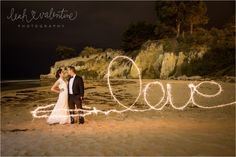 Wedding sparkler portraits on Leadbetter Beach in Santa Barbara, CA. Photo by Leah Valentine Photography.