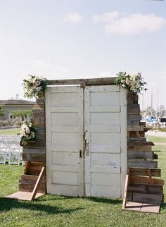 Modern wedding ceremony decor idea - wooden door with wood frame + floral details for processional {Boudoir Moderne by Allie Lindsey Photography}