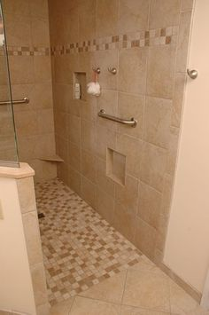 Universal design shower with grab bars by Neal's Design Remodel.