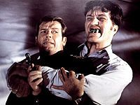 Roger Moore as Bond fighting Richard Kiel as Jaws inside Atlantis, in The Spy Who Loved Me.