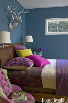 Go Bold: Don't be fooled. Dark colors do work in small spaces. Click through for more design solutions for small bedrooms.