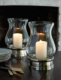 Hurricane candle holders on silver bases.