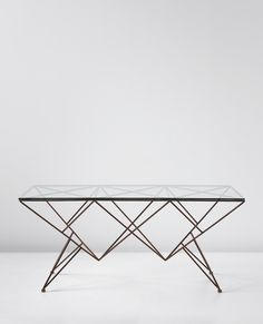 Giovanni Ferrabini; Enameled Iron, Glass and Brass Dining Table, c1957.