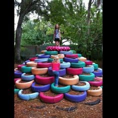 Old tires repurposed as playground equipment. This is the coolest king of the mountain idea ever =)