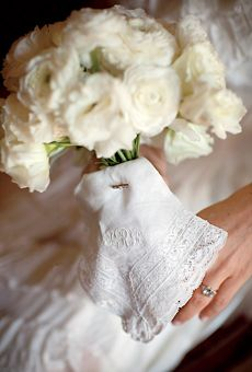Handkerchief wrapped around the bride's bouquet.