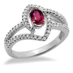 This contemporary ring features a beautiful designer oval shaped ruby surrounded by brilliant round cut diamonds in a 18k white gold setting. The color of the diamonds are G/H and the clarity is SI2/SI3.Different ring sizes may be available. Please inquire for details. $622.00