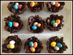 Gorgeous Chocolate Easter Eggs Nests - How cute are these! Made with cornflakes and mini m&m eggs. This recipe is the best for kids - for more baking and this easy recipe visit http://justamumnz.com/2014/04/11/easter-nests/