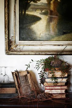 Beautiful arrangement....wall art, old books and natural elements