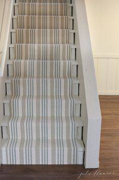 how to update stairs on a budget that will also be durable and easy to clean - this looks so beach!  Love this idea.