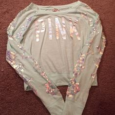 Victoria's Secret PINK Aztec bling crew shirt Victoria's Secret PINK seafoam mint green colored cropped shirt. Size xs. Long sleeves that are covered with beautiful sequins in an Aztec/tribal pattern. Never worn or washed. No tags. Brand new without tags. Cheaper on Ⓜ️ercari! Victoria's Secret Tops Tees - Long Sleeve