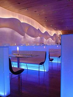 Another view of: /2010/05/Modern-Japanese-Restaurant-Interior-Design-by-Karim-Rashid- the booths are not attached to the cool lit walls...rather, stand alone benches. Makes for easier cleaning!