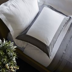 HOTEL CLASSIC - The style choice for many of the world's finest hotels, the Hotel Collection features double borders embroidered on crisp, durable, and easy-to-care-for cotton percale. Simple and timeless, the Hotel Collection brings the cosy indulgence of a luxury hotel stay into the home. Made in Italy.