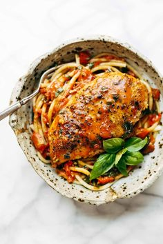 Garlic Basil Chicken - you won't believe that this easy real food recipe only requires 7 ingredients like basil, garlic, olive oil, tomatoes, and butter. #chicken #pasta #spaghetti #basil #easyrecipe | pinchofyum.com