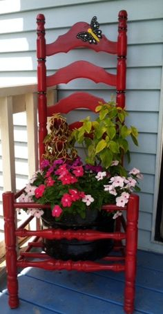 My version of a chair planter. I used an old ladder-back chair & an old rusted-out canner for the pot.....