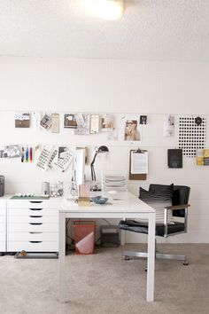 creative workspace - love the wall (wire to hang stuff on)
