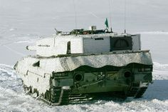 Norwegian Leopard 2A4NO with Saab Barracuda MCS (mobile camouflage system) in Schneetarn.