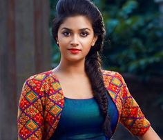 Keerthy Suresh will be playing the role of a doctor in REMO movie. Sivakarthikeyan & Keerthy Suresh starring REMO movie is directed by Bhagyaraj Kannan. Stylish Dress Designs, Stylish Dresses, Most Beautiful Indian Actress, Beautiful Actresses, Indian Film Actress, Indian Actresses, Salwar Designs, Blouse Designs, Film Awards