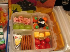 ham, green grapes, various halloween candy, flavored cheese spread, whole wheat ritz crackers, Monterrey Jack cheese cubes, grape tomatoes, cheddar cheese bunnies and a fruit cup