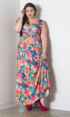 Eloise has a beautiful print of colored flowers . This gorgeous sleeveless maxi dress will be your go to dress for the season! • Ankle-length hemline  • Empire waist shows off the bust but provides full coverage  • Deep v-neck  • Waist ties for a perfect fit