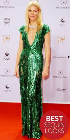 Gwyneth Paltrow wore a green sequin cap sleeve column gown with a plunging neckline and a cinched in waist. I love this shade of green! I love sequins! The plunging neckline adds sex appeal and the sequins add glam. The choker adds interest and pulls the look together.