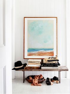 Accent interior decor with large art to add personality and color to an otherwise white space.