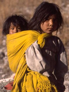 North America: In Mexico's Copper Canyon, a Tarahumara girl carries her baby sister on her back