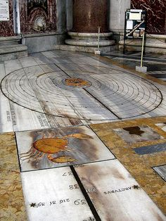 The Basilica of St. Mary of the Angels and the Martyrs in Rome:  At the beginning of the eighteenth century, Pope Clement XI commissioned the astronomer, mathematician, archaeologist, historian and philosopher Francesco Bianchini to build a meridian line, a sort of sundial, within the basilica. Completed in 1702, the object had a threefold purpose: the pope wanted to check the accuracy of the Gregorian reformation of the calendar, to produce a tool to predict Easter exactly, and…