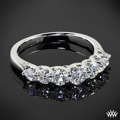 Completely stunning, this Custom 7 Stone Diamond Wedding Ring is set in 18k White Gold and has a lovely trellis design. Adorned with 0.86ctw A CUT ABOVE® Hearts and Arrows Diamond Melee in a graduating pattern
