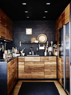 A dark kitchen designs you already not very often, but after seeing these pictures, I'll bet you a dark kitchen really what you will do !